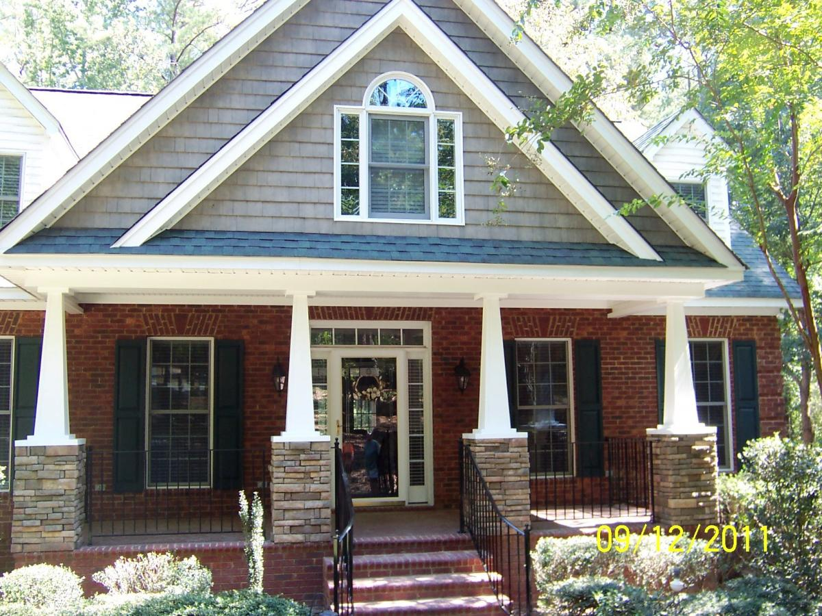 This Front Porch Makes A Statement The Stacked Stone Bases To New Columns Support Upper Redesigned Gable With