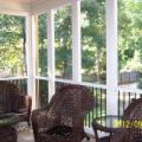 Aluminum framed screen room with black balusters